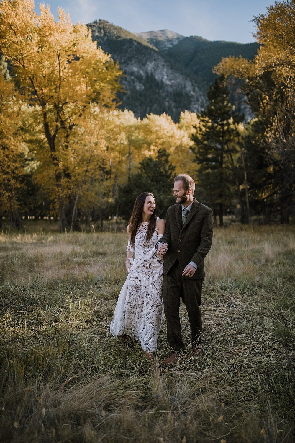 couple walking, norway elopement, post elopement celebration, wedding in the woods, buena vista elopement, buena vista wedding, nathrop colorado wedding, adventurous colorado elopement, farmers market