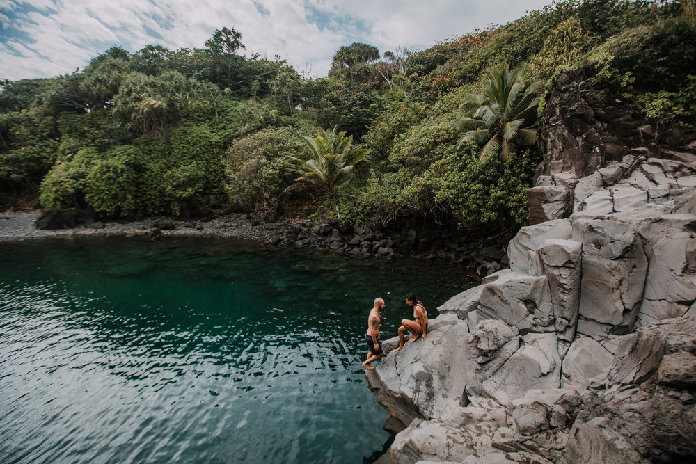couple on cliff, seven sacred pools at ohe'o, island hiking, road to hana, hawaii wedding photographer, hawaii elopement photographer, maui wedding, maui engagements, maui elopement