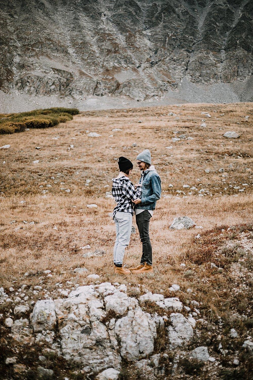 couple hugging, colorado surprise proposal, hike mayflower gulch, mayflower gulch proposal, mayflower gulch elopement, mayflower gulch wedding, colorado mountainscape, leadville elopement