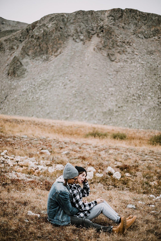 couple sitting, colorado surprise proposal, hike mayflower gulch, mayflower gulch proposal, mayflower gulch elopement, mayflower gulch wedding, colorado mountainscape, leadville elopement