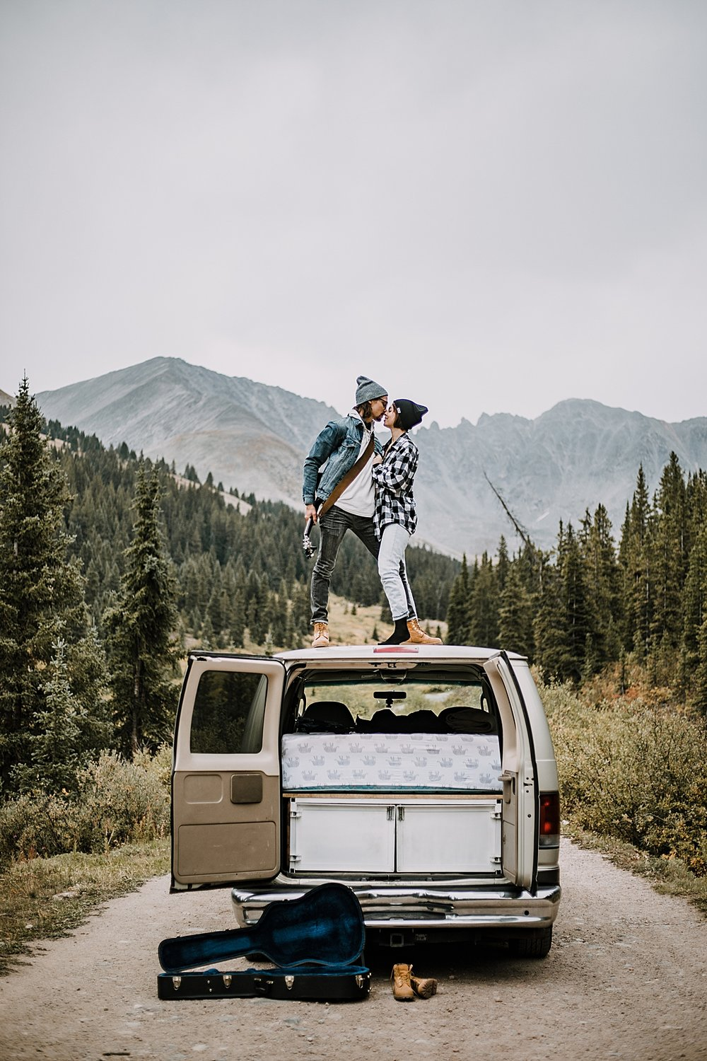 singing on van, couple living out of a van, van life with dogs, hiking mayflower gulch, mayflower gulch elopement, mayflower gulch wedding, colorado 14er, colorado fourteener, leadville elopement