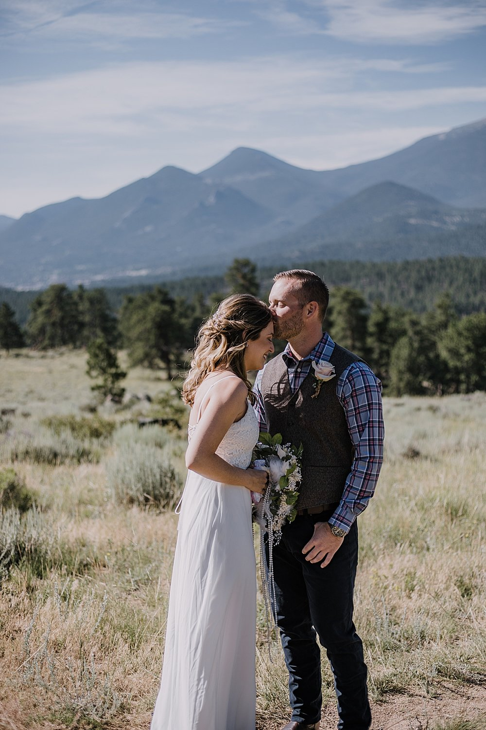 groom kissing bride, rocky mountain national park elopement, 3M curves elopement, self solemnizing, self solemnization, long's peak ceremony, hiking elopement, estes park elopement