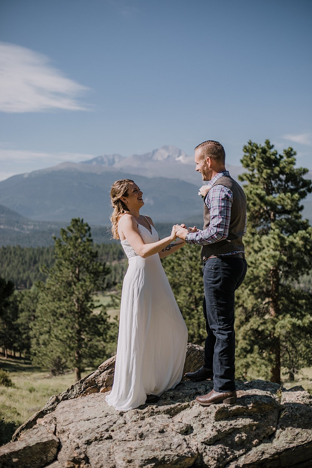 couple in front of long's peak, rocky mountain national park elopement, 3M curves elopement, self solemnizing, self solemnization, long's peak ceremony, hiking elopement, estes park elopement