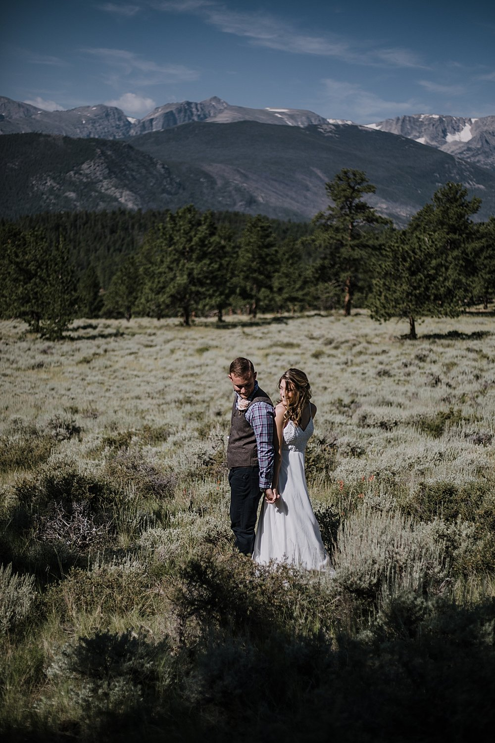 couple in field, RMNP elopement ceremony, rocky mountain national park elopement, 3M curves elopement, self solemnizing, self solemnization, long's peak, summer hiking elopement, estes park elopement