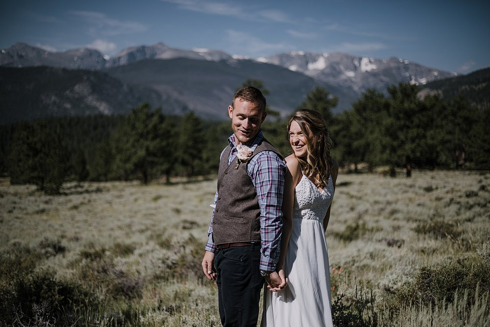 couple laughing, RMNP elopement ceremony, rocky mountain national park elopement, 3M curves elopement, self solemnizing, self solemnization, long's peak, summer hiking elopement, estes park elopement