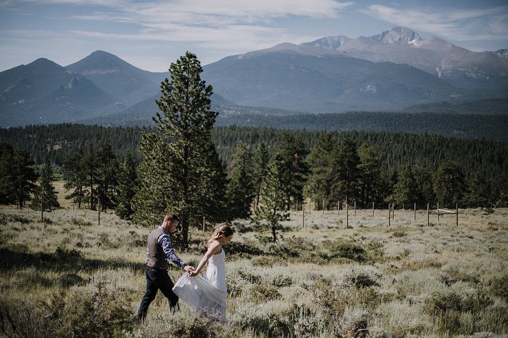 groom and bride hiking, RMNP elopement ceremony, rocky mountain national park elopement, 3M curves elopement, self solemnizing, self solemnization, long's peak, summer elopement, estes park elopement