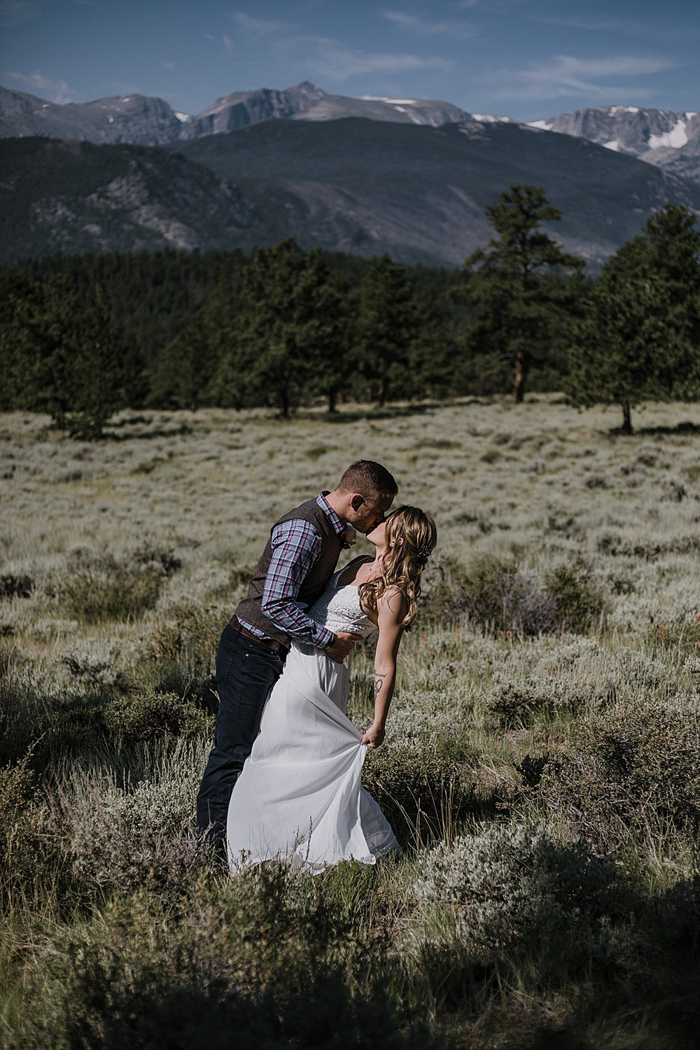 bride and groom dancing, RMNP elopement ceremony, rocky mountain national park elopement, 3M curves elopement, self solemnizing, self solemnization, long's peak, summer elopement, estes park elopement