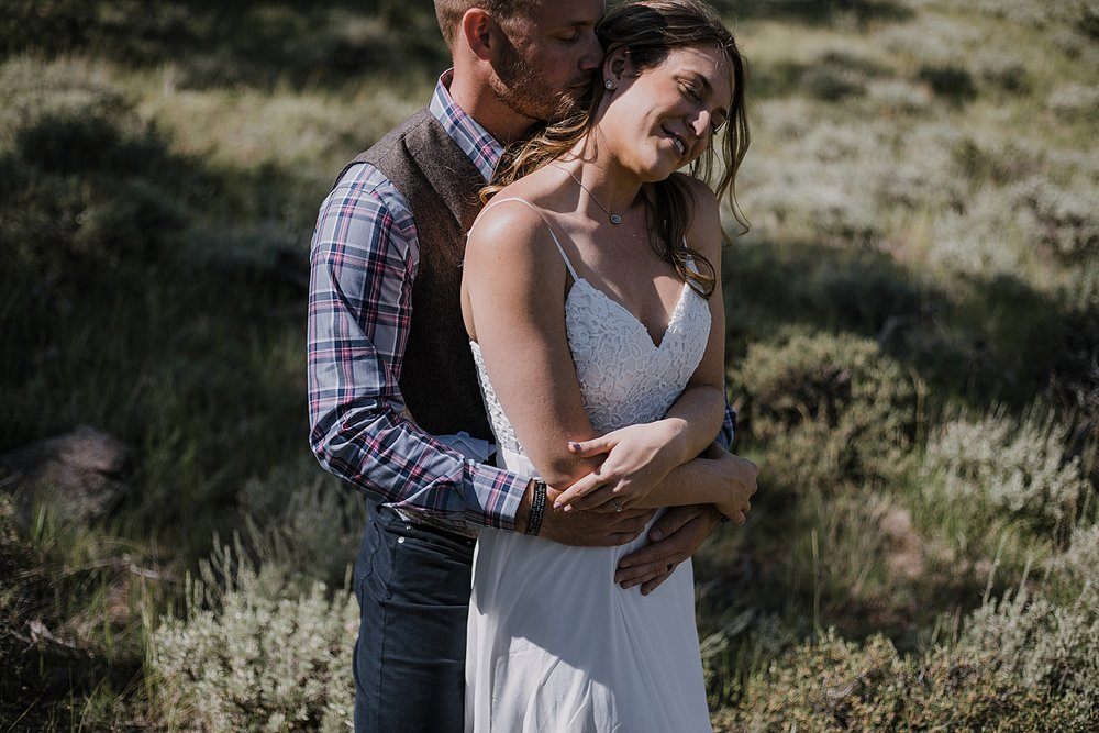 groom kissing bride, RMNP elopement ceremony, rocky mountain national park elopement, 3M curves elopement, self solemnizing, self solemnization, long's peak, summer elopement, estes park elopement