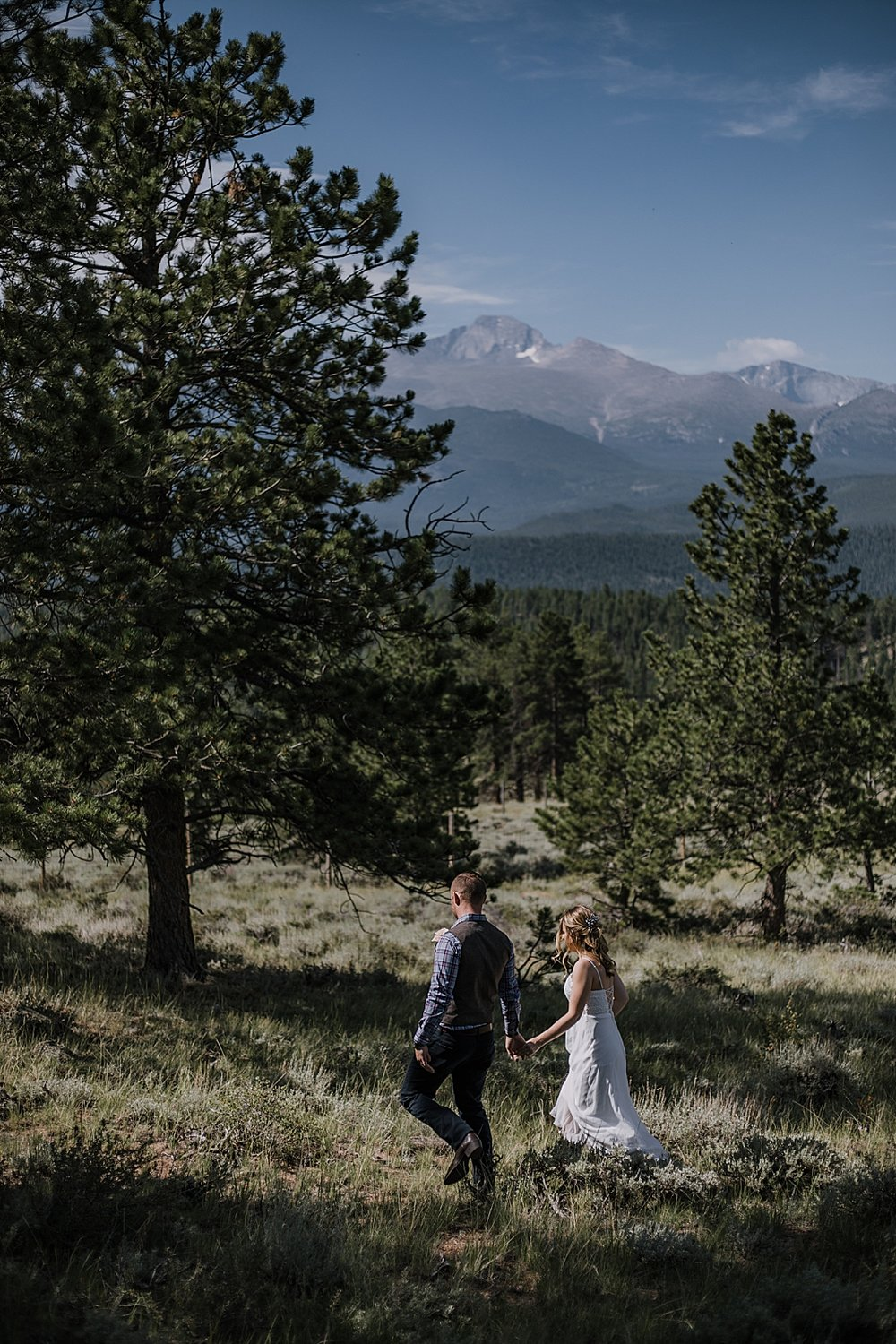 bride and groom hiking, RMNP elopement ceremony, rocky mountain national park elopement, 3M curves elopement, self solemnizing, self solemnization, long's peak, summer elopement, estes park elopement
