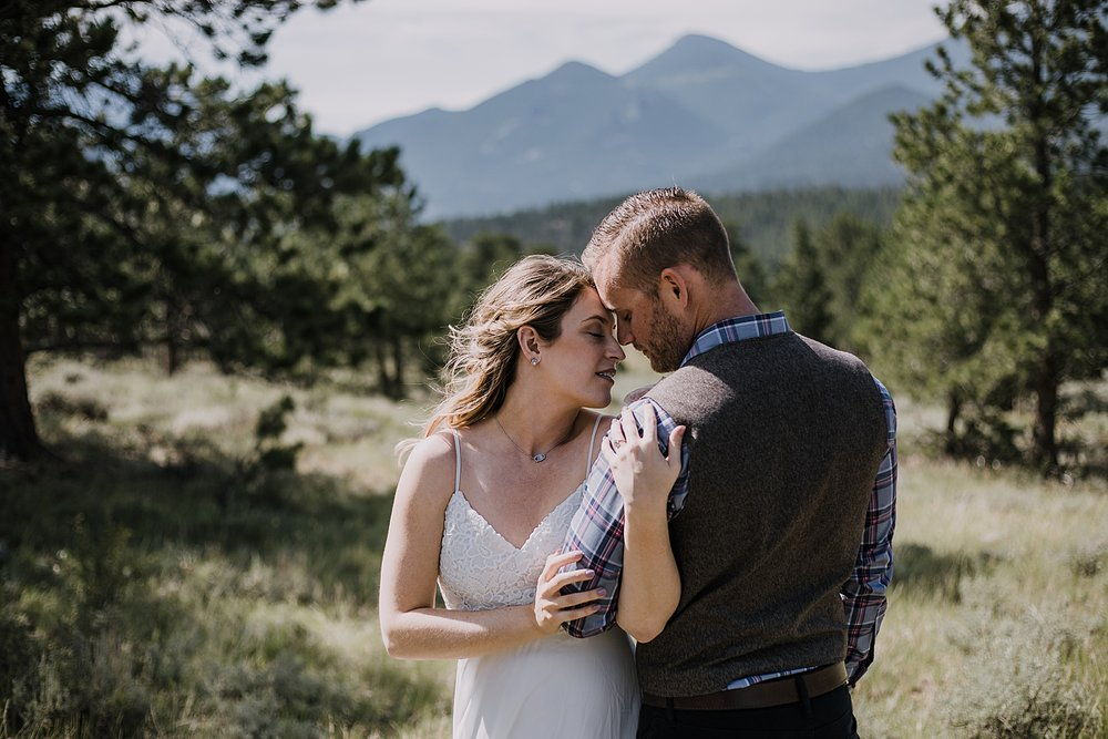 couple eloping, RMNP elopement ceremony, rocky mountain national park elopement, 3M curves elopement, self solemnizing, self solemnization, long's peak, summer elopement, estes park elopement