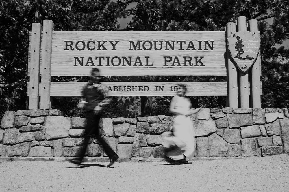 national park sign, RMNP elopement ceremony, rocky mountain national park elopement, 3M curves elopement, self solemnizing, self solemnization, long's peak, summer elopement, estes park elopement
