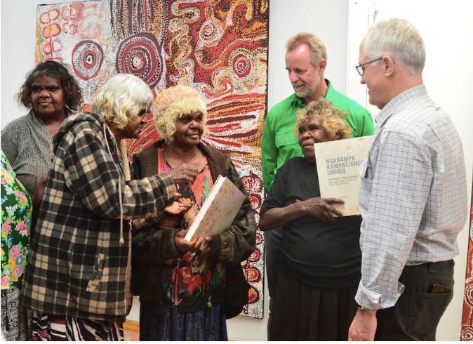 Jennifer Ingkatji, Nyurpaya Kaika, Naomi Kantjuriny and Iluwanti Ken present the Tjala Arts book to Minister Scullion and Prime Minister Malcolm Turnbull