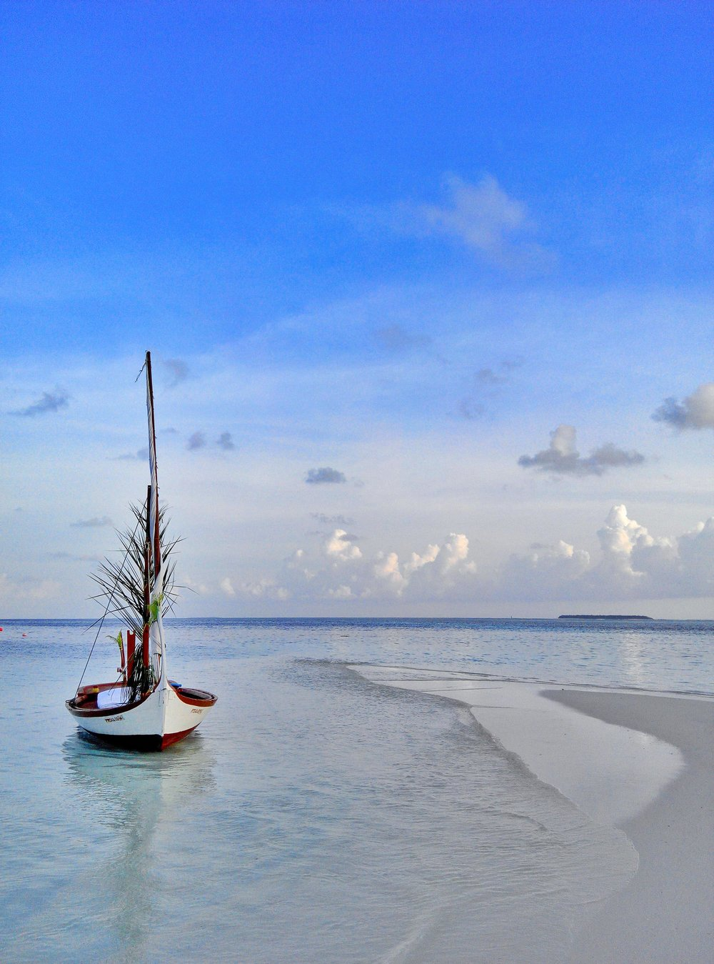 Rangali Island Maldives   A dingy made for two and only serves one purpose on such a scenic getaway.