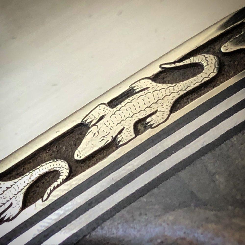 Randall Made Knives :  Deep Relief Alligator Border Closeup