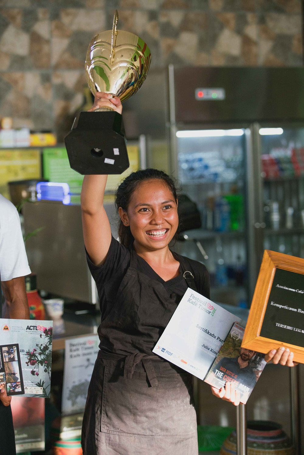First Barista Champion ofTimor-Leste  - Julia Ximenes won Timor-Leste's firstBarista Competition at the 2017 Festival Kafé Timor. She joined our team in October 2016, and within a year became, not only the nation's best barista, but also one of its first emerging coffee cupping judge. Julia's favourite methodis cold-brew coffee.  She is also pursuing her undergraduatedegree in finance at the National University of Timor-Leste.