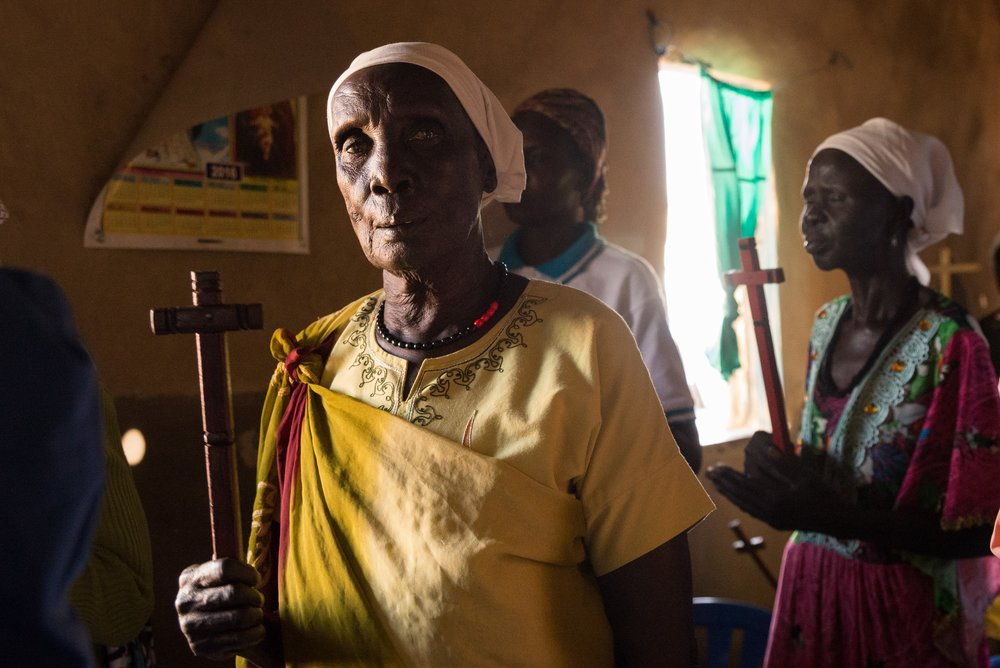 A Dinka woman holds a cross during a Protestant church service in Northern Uganda.