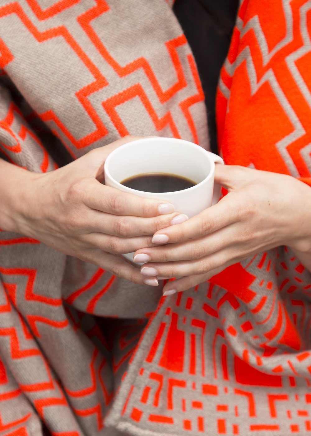 Duisdoorne Orange Blanket - Sit back, relax and treat yourself to a cup of tea while you curl up in a beautiful handmade blanket intended to keep you warm on those colder Summer nights. What a great addition to any living space!