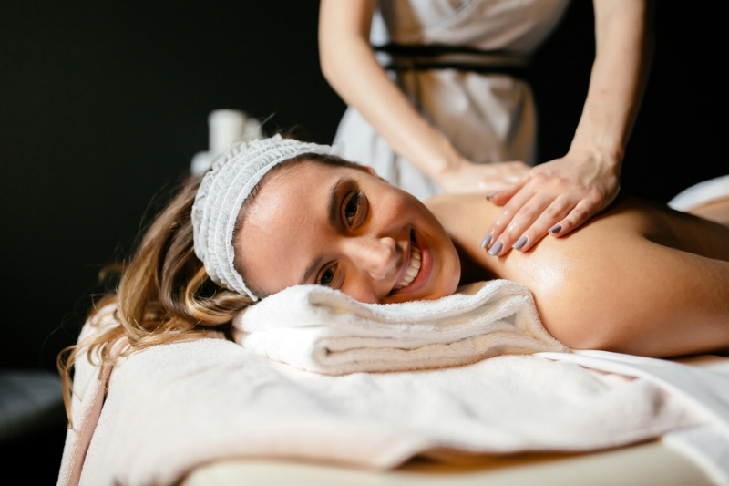 Woman is happy that she is receiving a massage