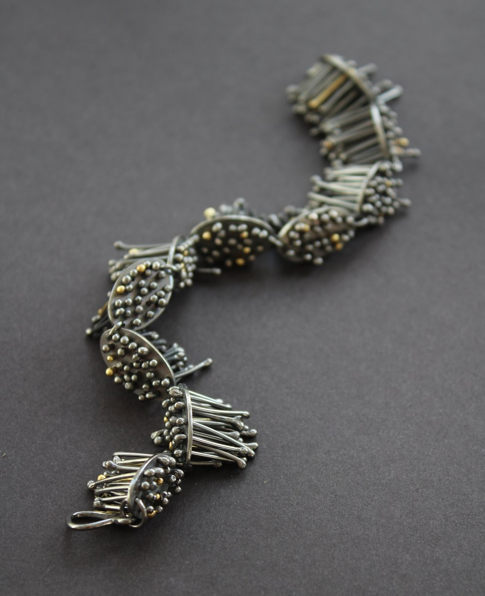 Oxidised with 18ct Gold