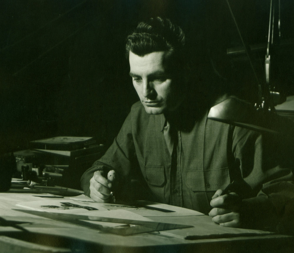 Rehberger in his Army Air Force uniform working at his drafting table (1943-1945).