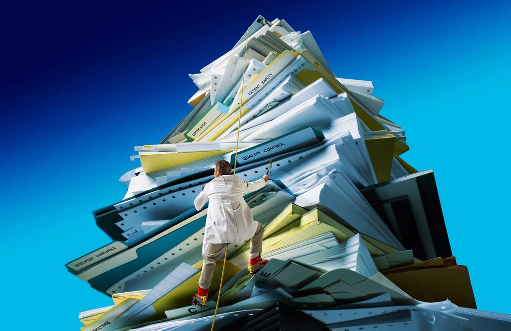 tiny-man-climbing-mountain-of-paper.jpg