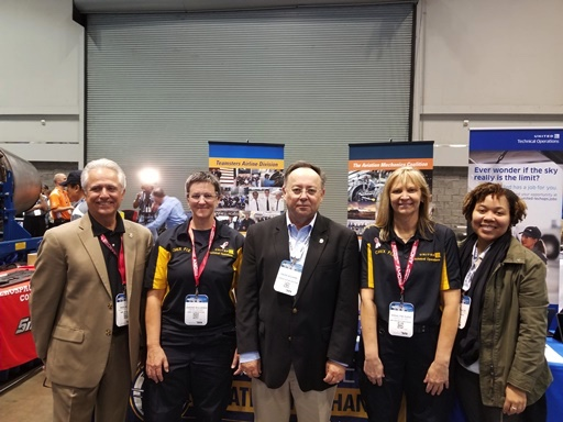(L to R) International Representative Paul Alves, USMC Veteran and Avionics Technician Joanne Mulherin (SFO-31 years) , Division Director David Bourne, Dana Eads (DEN MX Supervisor and Team Coach) and Deputy Division Director Allynn Allen at the MRO Competition.