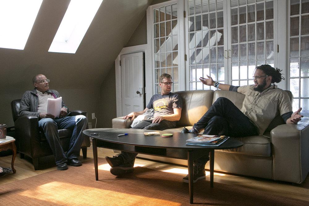 From left: Denver VOICE vendor Michael Burkley, Flobots Jamie Laurie and Stephen Brackett. Credit: Giles Clasen
