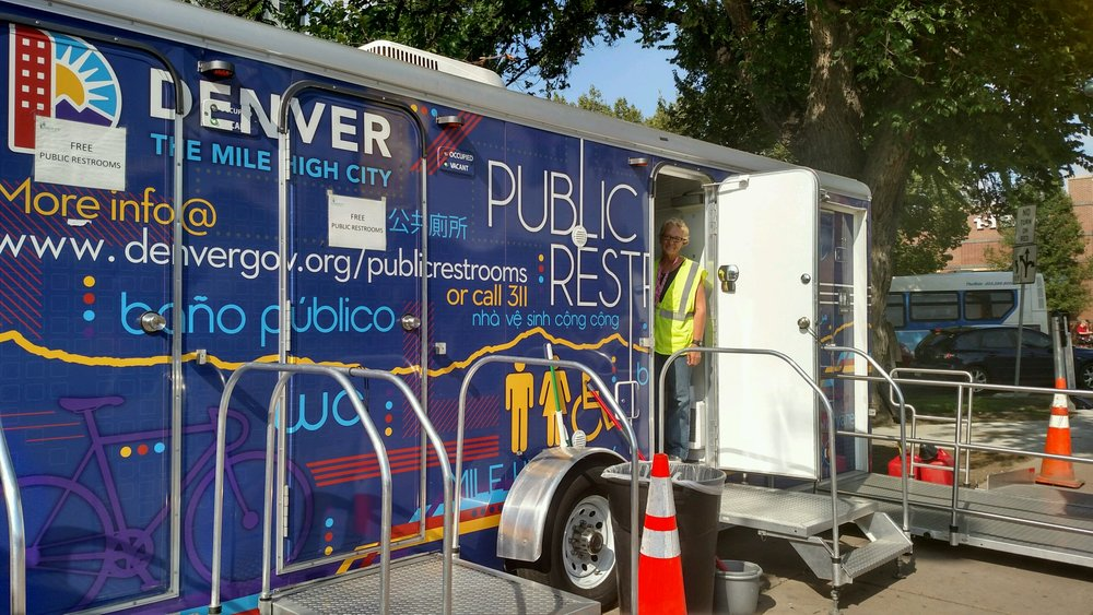 A mobile restroom at the intersection of Franklin and Colfax. Each restroom has three stalls and is maintained by an attendant. Credit: Sarah Ford