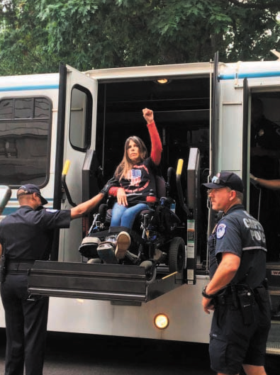 Dawn Russell is arrested June 22, 2017, following an action at Senator Mitch McConnell's office in Washington DC. ADAPT activists traveled to DC to speak with McConnell about their concerns regarding healthcare legislation. Credit: Dawn Russell