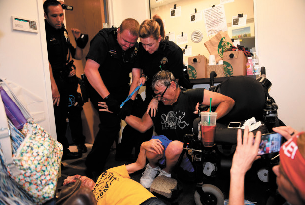 "ADAPT activists camped out in Cory Gardner's Denver office for two days, saying they wouldn't leave until the senator promised to vote ""no"" on the Senate healthcare bill. Credit: Dawn Russell."