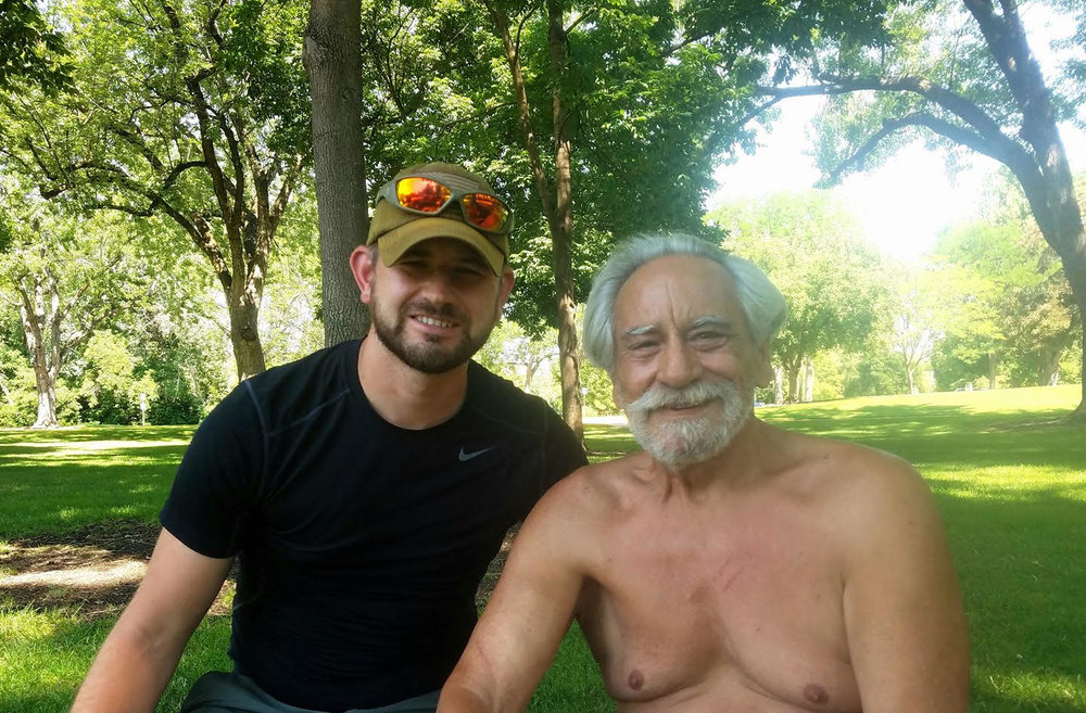 Brennan Silver (left) poses with a homeless Vietnam veteran living out of his van in Boise, ID. He was one of several veterans featured on Silver's video interviews. Credit: Brennan Silver