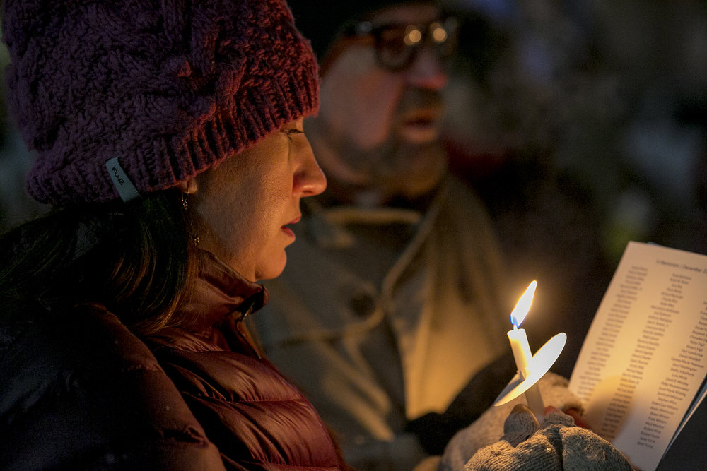 Laurel Radmore remembers a friend who died in the past year at the Colorado Coalition for the Homeless 28th Annual Homeless Persons' Memorial Vigil. Radmore is the Director of Residential Services for the Colorado Coalition for the Homeless. (Credit: Giles Clasen)