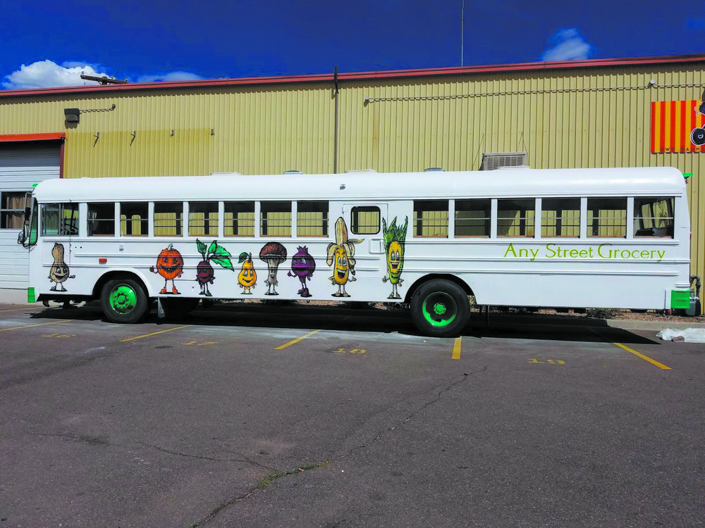 Any Street Grocery operates out of a re-painted school bus, allowing them to travel to different neighborhoods throughout the Denver metro area. (Credit: Any Street Grocery)