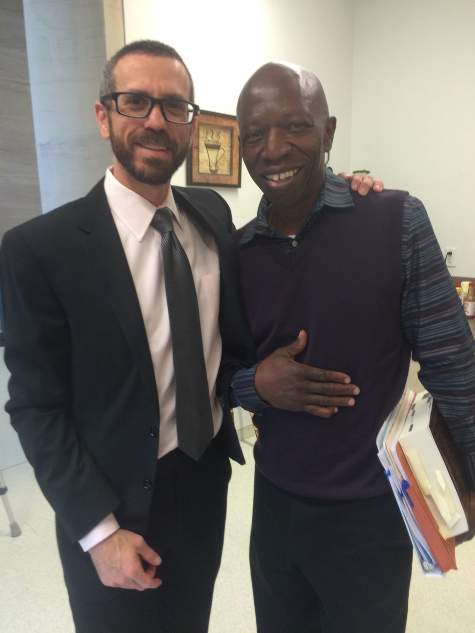 Attorney Eric Klein stands with Clarence Moses-El after a status hearing in Denver's courthouse. (Credit: Eric Klein)