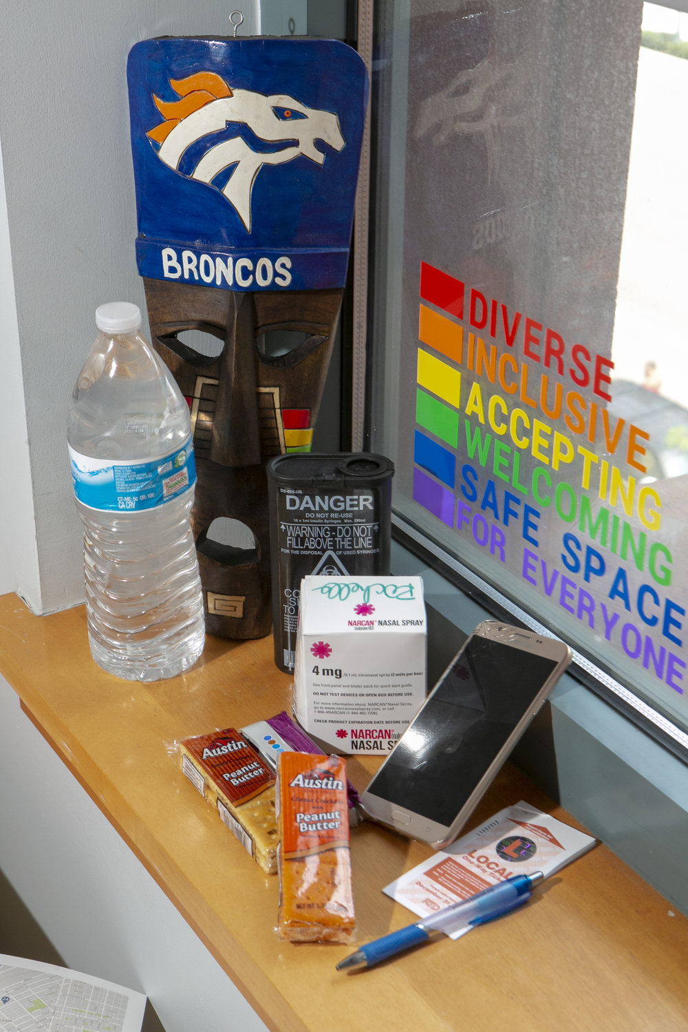 The Denver Public Library  Community Resource Specialists carry a blend of supplies to help unhoused customers. The supplies include everyday necessities like socks, snacks, and water. The team also carries the life-saving tool Narcan, a nasal spray used to treat emergency opioid overdose. Elissa Hardy, community resource manager, introduced the Narcan treatment program to the library in 2015. Currently, 400 DPL library staff are trained to administer Narcan in emergencies and in the past year have saved 17 lives.