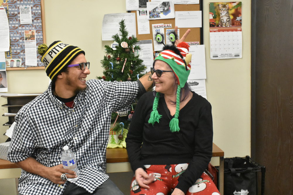 Raelene Johnson and her son, Jamar, met face-to-face for the first time in over 20 years in December. Jamar visited the VOICE office with Raelene to meet fellow vendors and staff on December 13. (Credit: Sarah Ford)