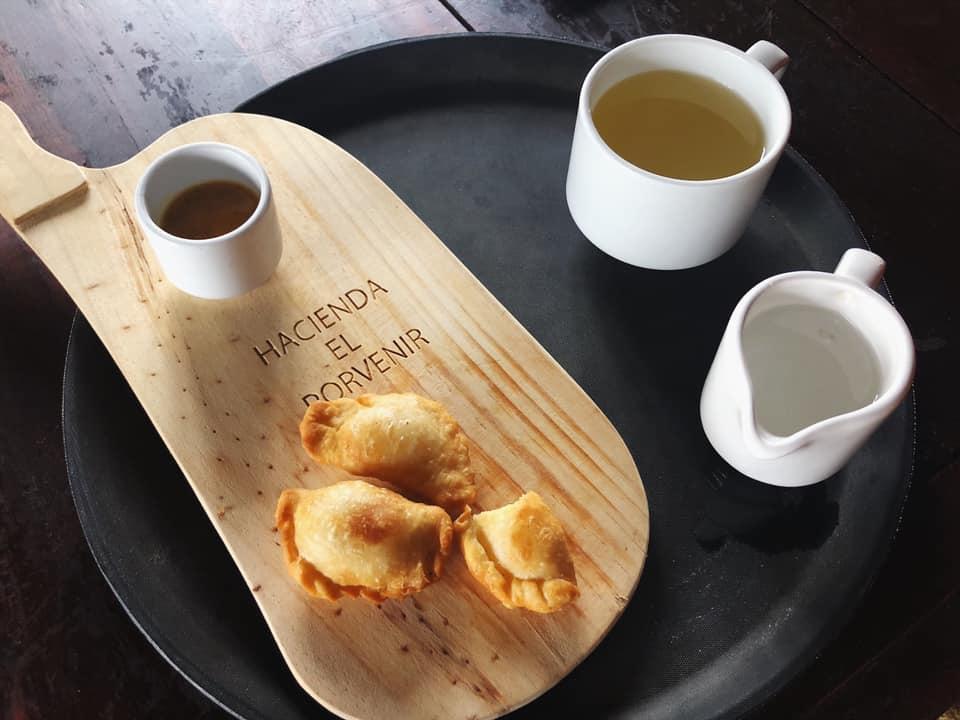 A traditional welcome tea & cheese empanadas