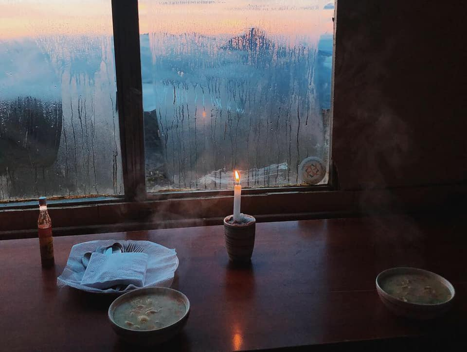 Candlelit dinner with a sunset view of Illiniza Norte