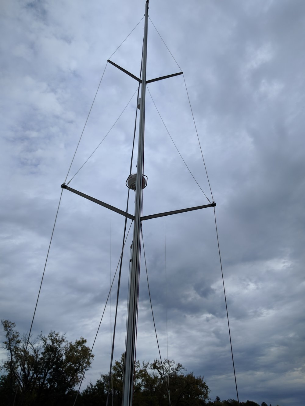The mast is hoisted back in place.