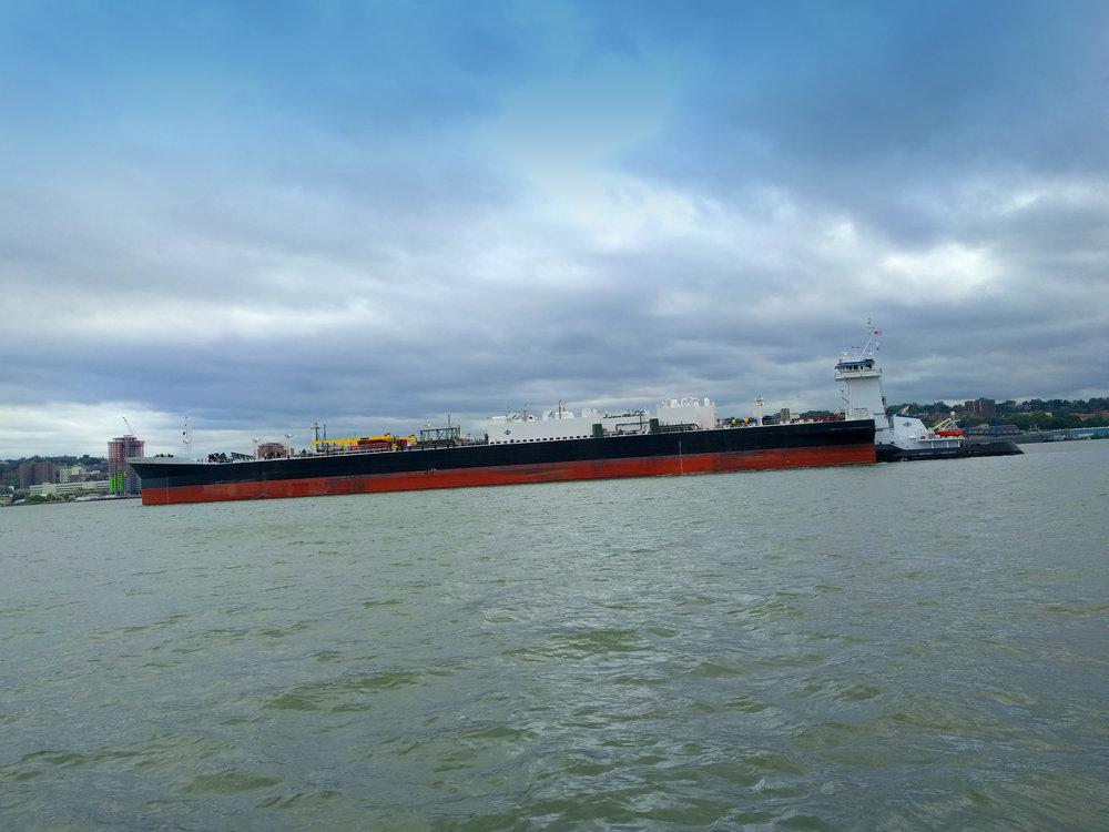 Tug driven barge.