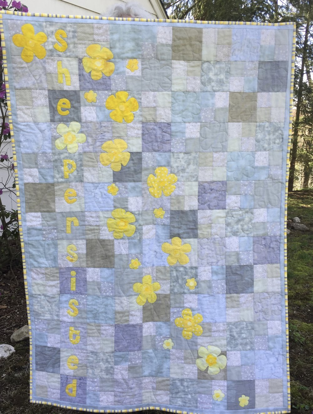 "Blanket Statement  is inspired by Hillary Clinton's line, ""Bloom where you are planted."" This crib quilt was auctioned off to raise money for local community gardens in Chappaqua NY. Pattern coming soon! Make one for your future feminist!"