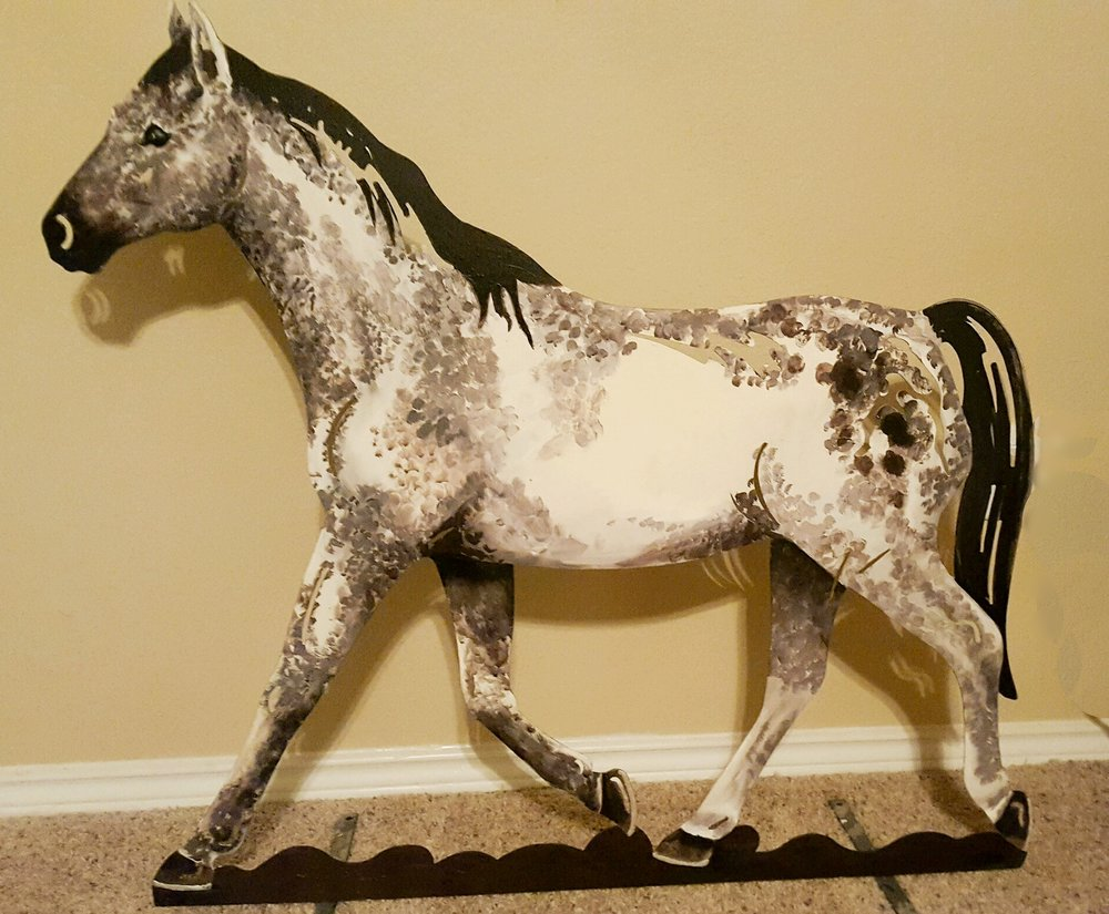 Roan horse painted on a supplied metal cut out.  Reflective paint on the white areas makes it really shine at night. 3 d eye and silver foil shoes.