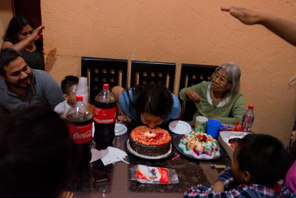 Marlen celebrates her 27th birthday as her family cheers for her to put her face into her cake.