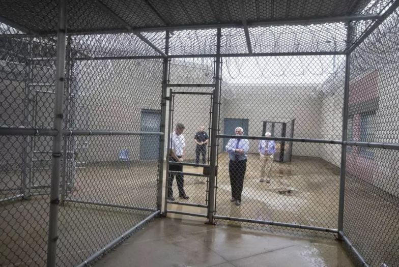 STAN GROSSFELD/GLOBE STAFF An inside view from the exercise cage at the Bristol County House of Corrections. Third from left is Sheriff Thomas Hodgson.