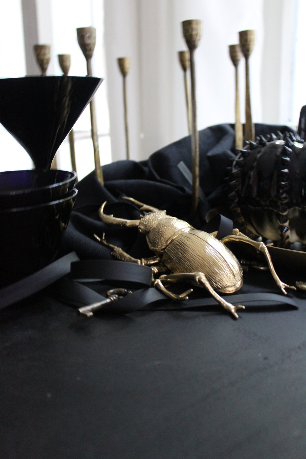 CREEPY CRAWLERS...break out the spray paint again and gild your beetles and bugs! Place the smaller sized in inconspicuous places for your guests to find throughout the evening.