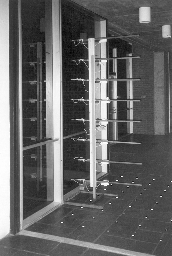 A thermometric device, with eight thermometers at one-foot intervals captures the subtle microclimates of an aluminum and glass enclosure on a cold winter night