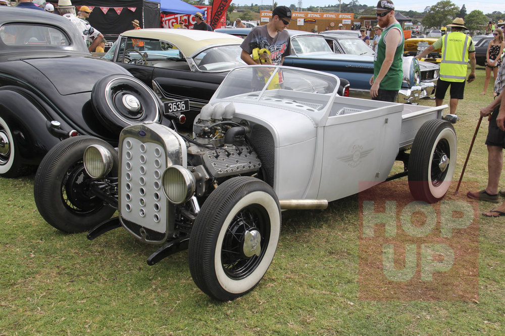 Neil Surtees is one very clever man. His Model A roadster pickup features a handcrafted (by Neil) all aluminium body with over 5000 rivets holding it together. The detail is incredible and some of the features include a pickup bed which slides back to access the rear radiators for the flathead Ford V8 engine. The chassis is underslung and the screen is slightly curved but emulates a later early Ford shape.