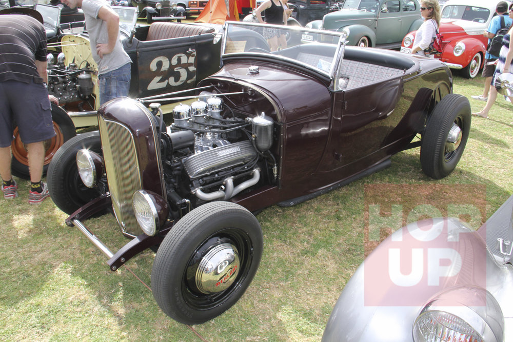 Kelly O'Donnell's Caddy powered Model A roadster runs a four speed and quick change rear end. Dig the Mercury hubcaps.