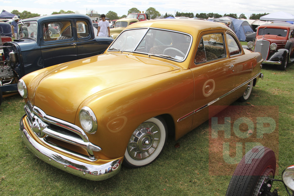 Mike Watkins is one of the young guys of the scene with this cool gold '49 Ford coupe running Caddy hubcaps. He drives it everywhere with a smallblock Ford under the hood.