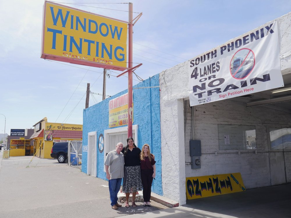 South Phoenix business owners Larry Cohen (left), Celia Contreras (center) and Racel Palopoli (right) pose for a portrait at Tony's Window Tinting on April 4, 2018. The trio have been collecting signatures for a petition opposing the City of Phoenix's light rail expansion plan.  (Nick Serpa/azcentral)